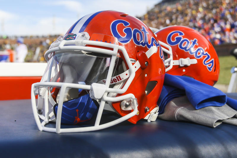 Florida Gators helmets sit atop a table.