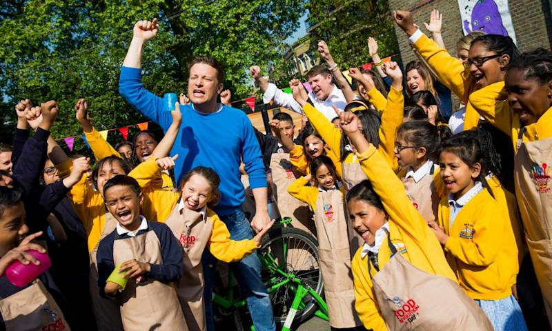 Jamie Oliver joins children from St Paul's Whitechapel CE Primary school to celebrate the third annual Food Revolution Day in 2014.