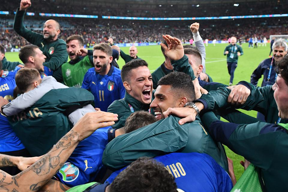 Italy's players celebrate after winning the UEFA EURO 2020 semi-final football match between Italy and Spain at Wembley Stadium in London on July 6, 2021. (Photo by JUSTIN TALLIS / POOL / AFP) (Photo by JUSTIN TALLIS/POOL/AFP via Getty Images)