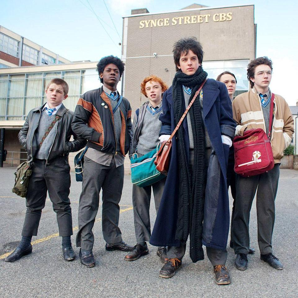"""<p>Sing Street is the name a group of eclectic high schoolers give their Irish rock band in John Carney's <em>other</em> musically inclined hit film. <em>Once</em> is probably the auteur's greatest hit, but operating under the assumption that you may already be hip to """"Falling Slowly"""" and the others brilliant songs from that film, we're highlighting this Dublin charmer. Capturing the film's rebellious, angsty, and free spirit, the song list plays with vintage hits and original compositions—from Duran Duran's """"<a href=""""https://www.youtube.com/watch?v=nTizYn3-QN0"""" rel=""""nofollow noopener"""" target=""""_blank"""" data-ylk=""""slk:Rio"""" class=""""link rapid-noclick-resp"""">Rio</a>"""" and The Cure's """"<a href=""""https://www.youtube.com/watch?v=EXGZCv2mb-Q"""" rel=""""nofollow noopener"""" target=""""_blank"""" data-ylk=""""slk:In Between Days"""" class=""""link rapid-noclick-resp"""">In Between Days</a>"""" to Sing Street's """"<a href=""""https://www.youtube.com/watch?v=P6TAz4BGFj8"""" rel=""""nofollow noopener"""" target=""""_blank"""" data-ylk=""""slk:To Find You"""" class=""""link rapid-noclick-resp"""">To Find You</a>"""" and """"<a href=""""https://www.youtube.com/watch?v=A0PHEC-HdfA"""" rel=""""nofollow noopener"""" target=""""_blank"""" data-ylk=""""slk:A Beautiful Sea"""" class=""""link rapid-noclick-resp"""">A Beautiful Sea</a>."""" There's even a lesser-known track from Adam Levine called """"<a href=""""https://www.youtube.com/watch?v=14yevQ-x-Gc"""" rel=""""nofollow noopener"""" target=""""_blank"""" data-ylk=""""slk:Go Now"""" class=""""link rapid-noclick-resp"""">Go Now</a>"""" that you'll instantly love.</p><p><a class=""""link rapid-noclick-resp"""" href=""""https://www.amazon.com/Sing-Street-Lucy-Boynton/dp/B01IJD71TC?tag=syn-yahoo-20&ascsubtag=%5Bartid%7C10056.g.32872244%5Bsrc%7Cyahoo-us"""" rel=""""nofollow noopener"""" target=""""_blank"""" data-ylk=""""slk:Watch and Listen"""">Watch and Listen</a></p>"""