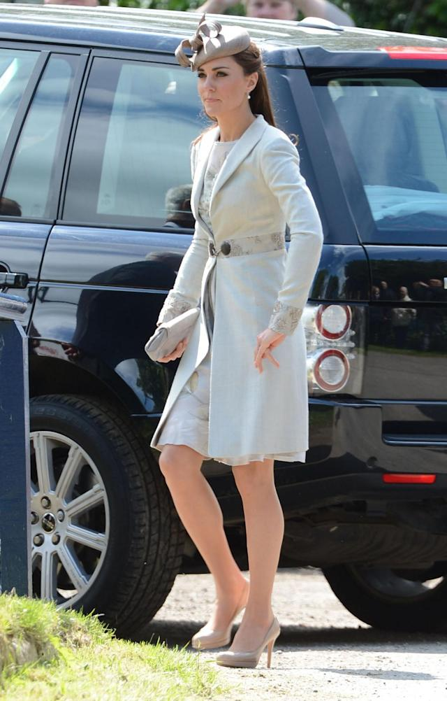 <p>The Duchess looked lovely in an elegant Jenny Packham coat and dress at a wedding in the summer of 2012. <em>(Photo: PA)</em> </p>