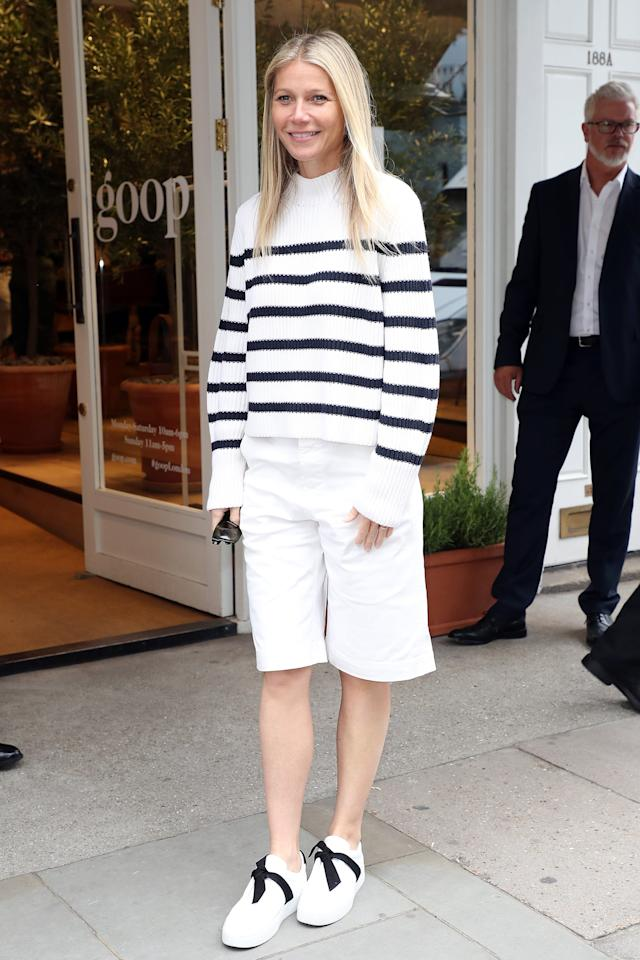 <p>Gwyneth coordinated her stripes perfectly with her Alexandre Birman bow sneakers for a book signing in London in 2019.</p>