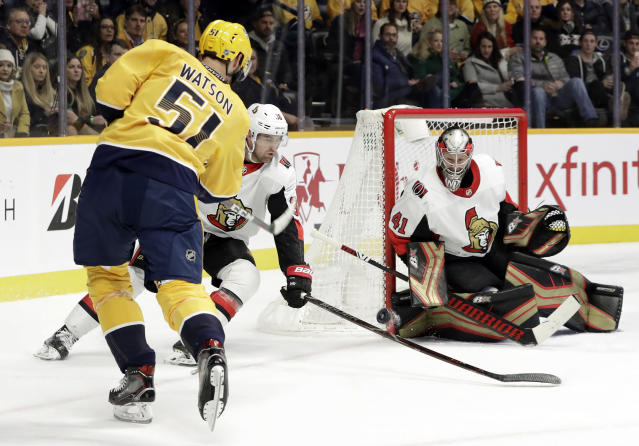 Nashville Predators left wing Austin Watson (51) shoots against Ottawa Senators goaltender Craig Anderson (41) in the second period of an NHL hockey game Tuesday, Dec. 11, 2018, in Nashville, Tenn. (AP Photo/Mark Humphrey)