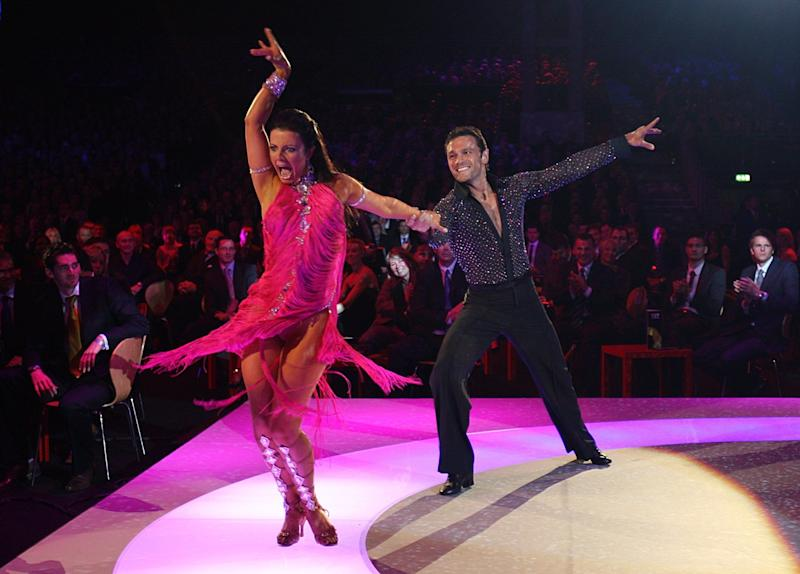 Cricket player Mark Ramprakash took home the glitter-ball trophy a year later. Here he is performing with his professional partner, Karen Hardy, at the BBC Sports Personality Of The Year Awards a year after his victory.