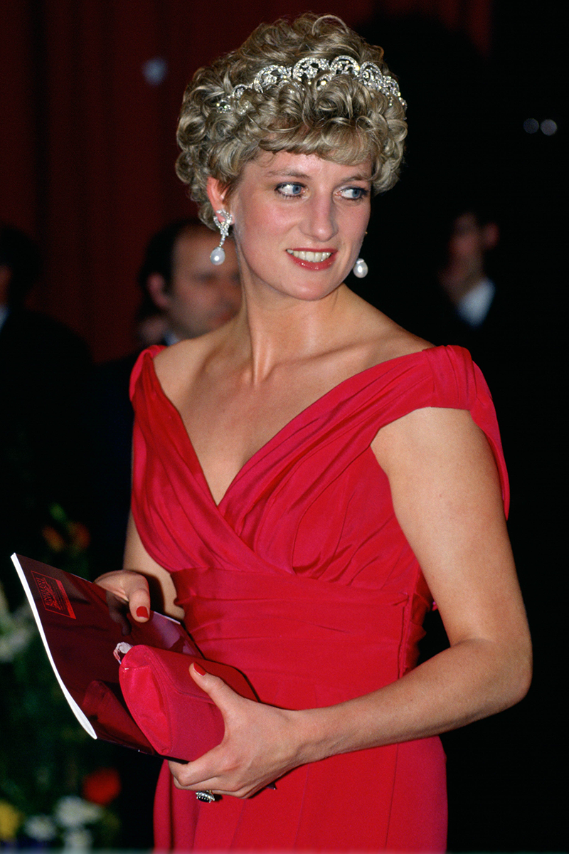 <p>Diana attended the English National Ballet gala performance in Budapest in March 1992 wearing a stunning ruby red evening gown with a boat neck collar, which she then accessorised with the Spencer family tiara.</p>