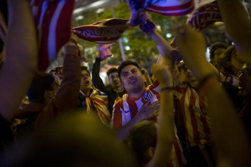 Atletico Madrid supporters celebrate their team's Europa League title in Madrid, Wednesday, May 16, 2018. Atletico defeated Marseille 3-0 in the final and clinches its third Europa League title. (AP Photo/Francisco Seco)