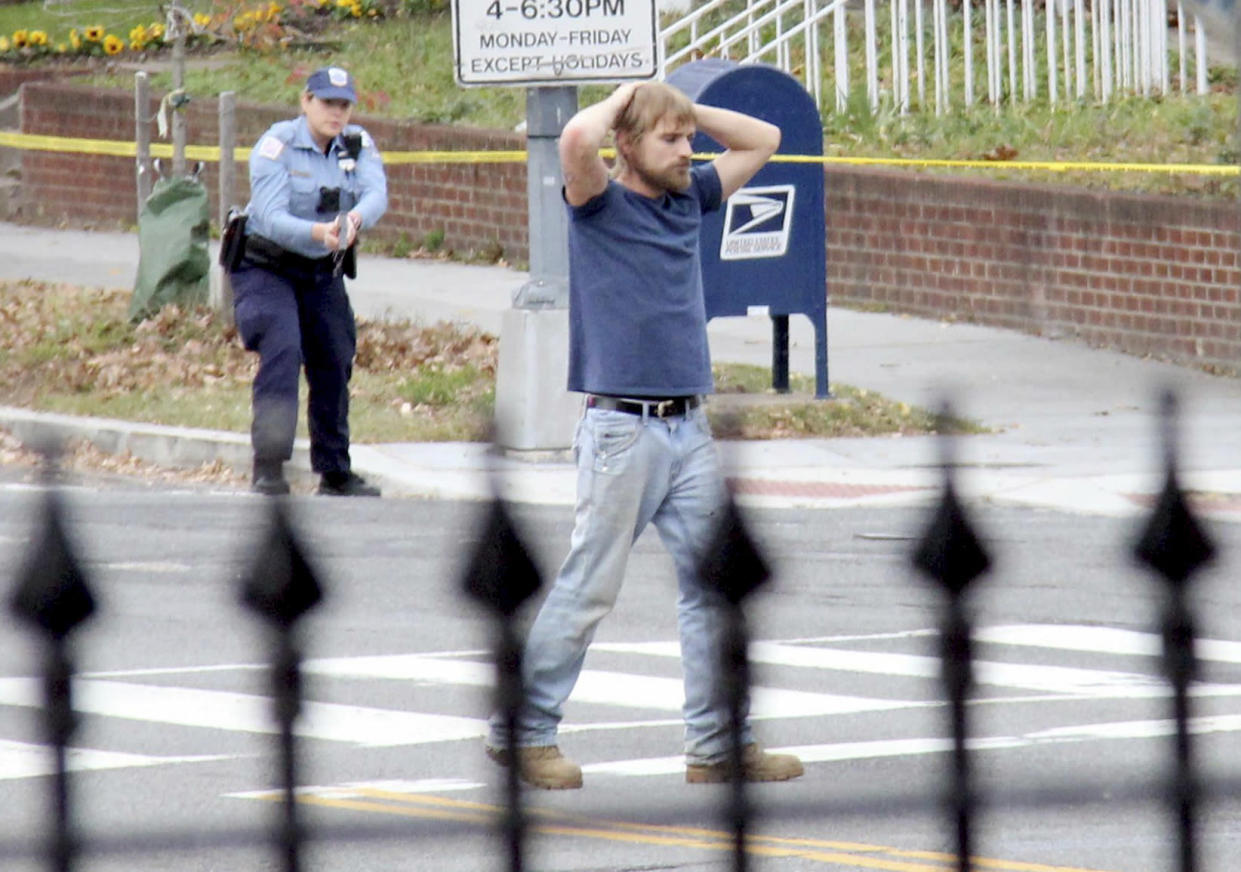 Edgar Maddison Welch, 28 of Salisbury, N.C., surrenders to police in Washington in 2016. Welch, a man who police said was inspired by false internet rumors dubbed Pizzagate to fire an assault weapon inside a Washington pizzeria, pleaded guilty in 2017 to two charges. (Photo: Sathi Soma via AP)