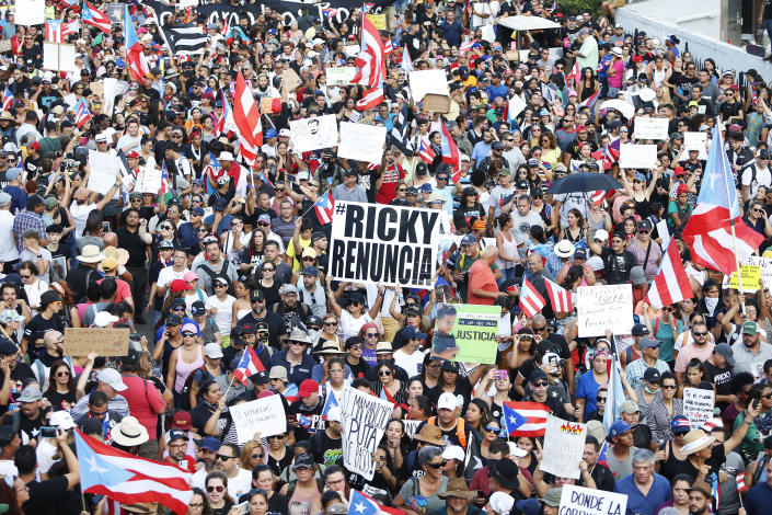 Thousands of demonstrators protesting against Ricardo Rossello, the Governor of Puerto Rico July 17, 2019 in front of the Capitol Building in Old San Juan, Puerto Rico. The sign reads Ricky resign. (Photo: Jose Jimenez/Getty Images)