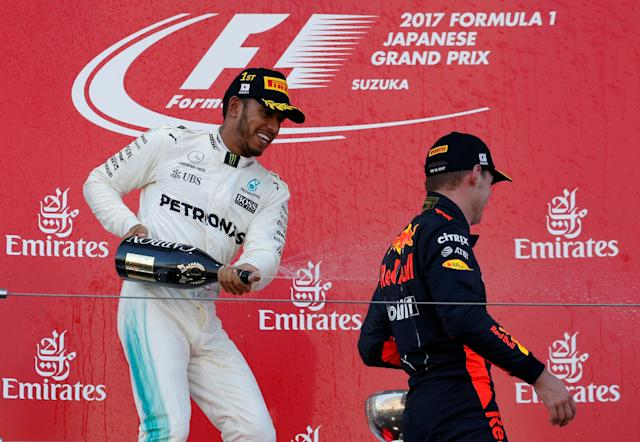<p>Formula One F1 – Japanese Grand Prix 2017 – Suzuka Circuit, Japan – October 8, 2017. Mercedes' Lewis Hamilton of Britain celebrates winning the race next to Red Bull's Max Verstappen of the Netherlands. REUTERS/Toru Hanai</p>