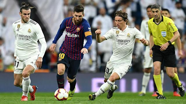 Real Madrid's Luka Modric handed the Ballon d'Or trophy to Lionel Messi on Monday and then expressed his respect for the Barcelona forward.