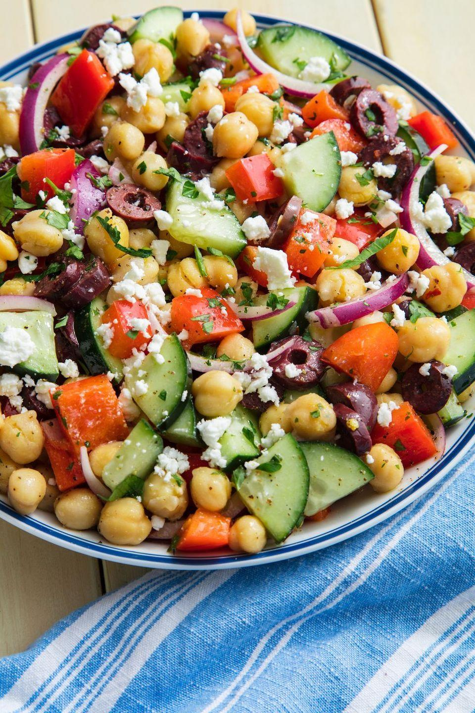 "<p>Thanks to the chickpeas, this salad will keep you full for hours. It's satisfying in a way that leafy greens never could be. Sorry not sorry, kale.</p><p>Get the <a href=""https://www.delish.com/uk/cooking/recipes/a29843193/mediterranean-chickpea-salad-recipe/"" rel=""nofollow noopener"" target=""_blank"" data-ylk=""slk:Mediterranean Chickpea Salad"" class=""link rapid-noclick-resp"">Mediterranean Chickpea Salad</a> recipe.</p>"
