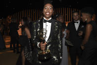 <p><em>Master of None</em> star Lena Waithe, who also made Emmy history for being the first African-American woman to win best writing for a comedy, looked happy clutching that trophy at the Governors Ball. (Photo: Richard Shotwell/Invision/AP) </p>