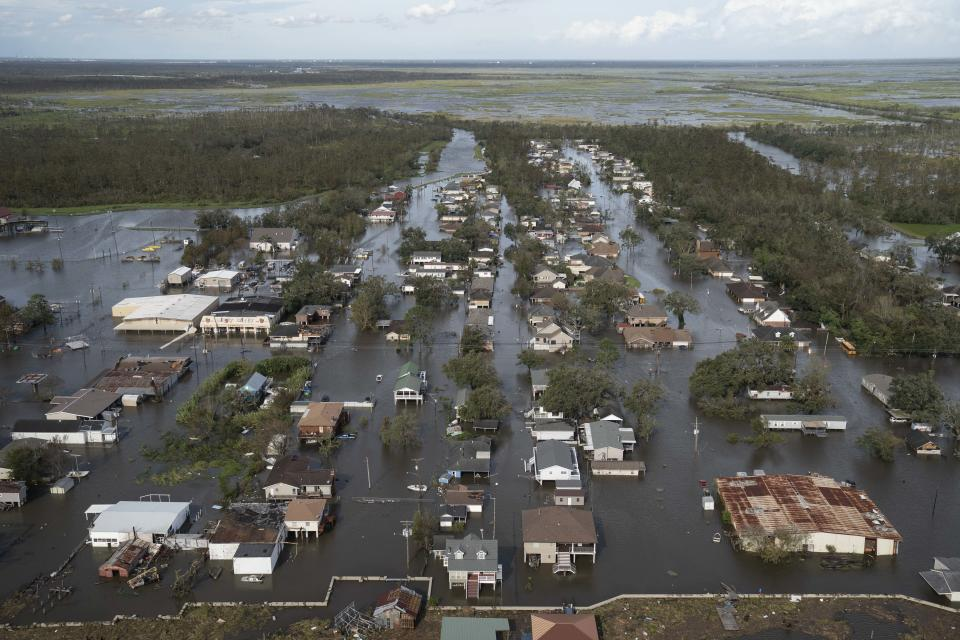 Homes and streets are overwhelmed by water on August 30, 2021 in Lafitte, Louisiana. (Michael Robinson Chavez/the Washington Post via Getty Images)