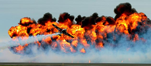 The Tinstix of Dynamite team performs in front of a massive wall of fire at the Melbourne International Airshow. The team mix dangerous flying techniques with dramatic fire displays to provide an explosive show (Alex Coppel / Newspix / Rex Features)<br /><br />