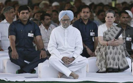 Outgoing Indian PM Manmohan Singh along with India's Congress party chief Sonia Gandhi sit after paying respects at the Rajiv Gandhi memorial during the former Indian PM's 23rd death anniversary, in New Delhi