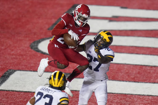 Rutgers' Aron Cruickshank (2) catches a pass for a touchdown in front of Michigan's Hunter Reynolds (27) during the second half of an NCAA college football game Saturday, Nov. 21, 2020, in Piscataway, N.J. Michigan won 48-42. (AP Photo/Frank Franklin II)