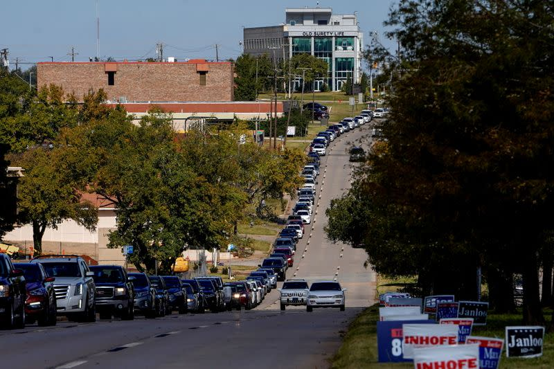 Voters wait in a long line of cars during early voting at the Oklahoma Election Board in Oklahoma City