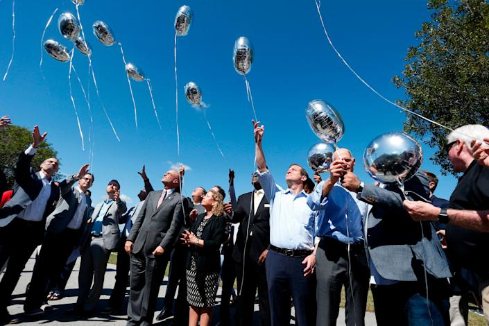 City, county and state officials release balloons in honor of the victims.