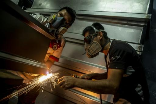 While the Peruvian economy has stagnated during months of coronavirus restrictions, coffin maker Genaro Cabrera has quadrupled his sales