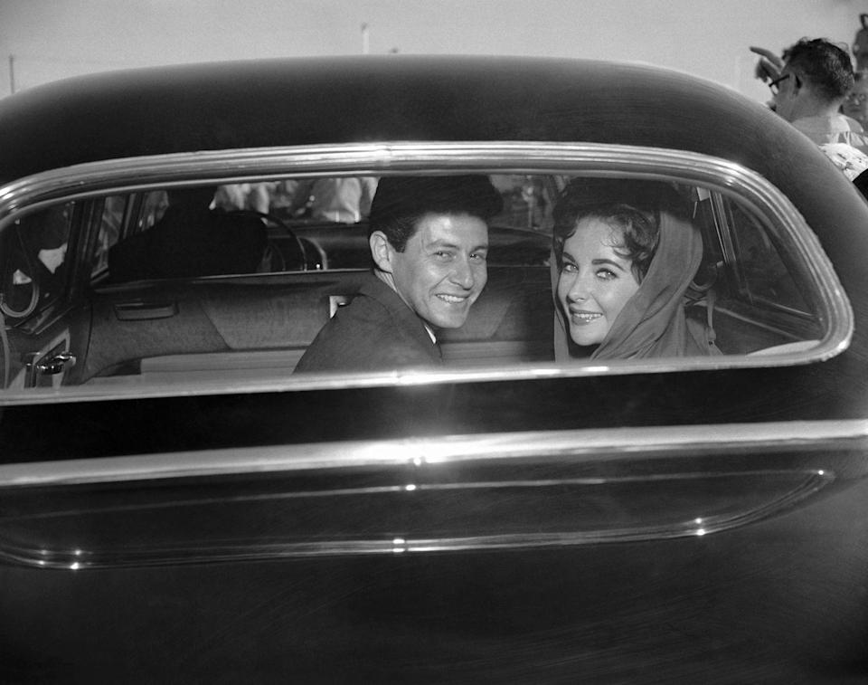 <p>Eddie Fisher and Elizabeth Taylor leaving their wedding in 1959. Fisher and Taylor would divorce in 1964.</p>