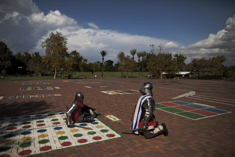 In this Oct. 26, 2012 photo, immigrants from the former Soviet Union practice sword-fighting in full knight armor, in a public park in Ramat Gan, central Israel. Medieval combat simulation is popular in ex-Soviet countries and some immigrants have continued the hobby in Israel. (AP Photo/Oded Balilty)