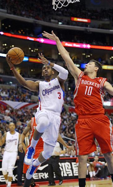 Los Angeles Clippers guard Chris Paul (3) shoots as Houston Rockets forward Carlos Delfino, of Aregentina, defends during the first half of their NBA basketball game, Wednesday, Feb. 13, 2013, in Los Angeles. (AP Photo/Mark J. Terrill)