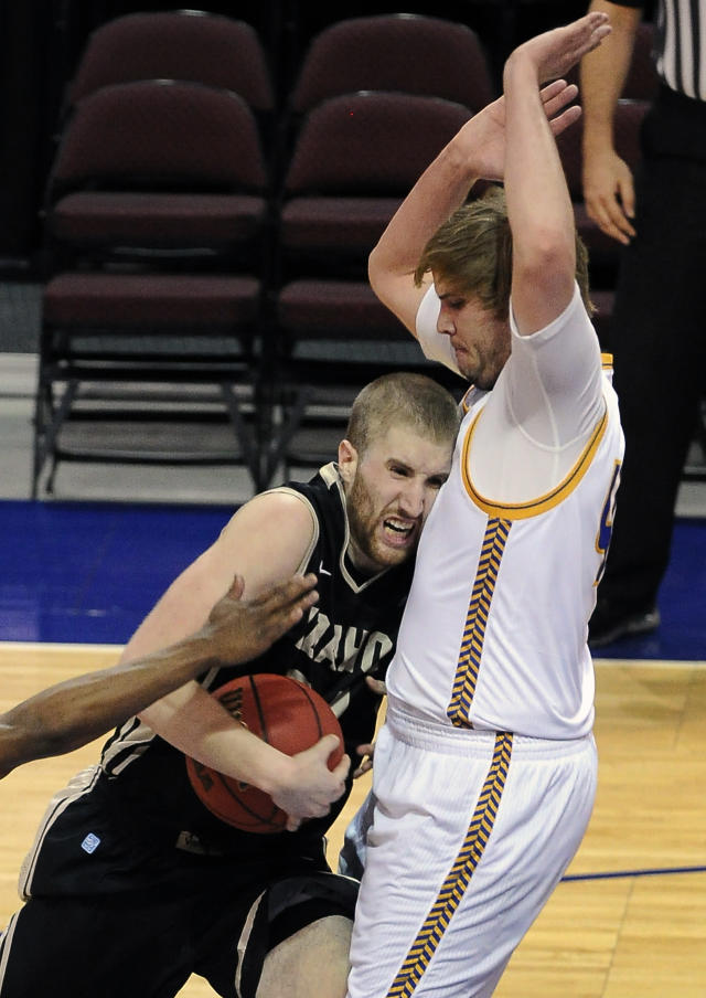 Idaho's Stephen Madison, left, runs into UMKC's Kirk Korver during the second half of an NCAA college basketball game in the first round of the West Athletic Conference men's tournament on Thursday, March 13, 2014, in Las Vegas. Idaho won 73-70. (AP Photo/David Becker)