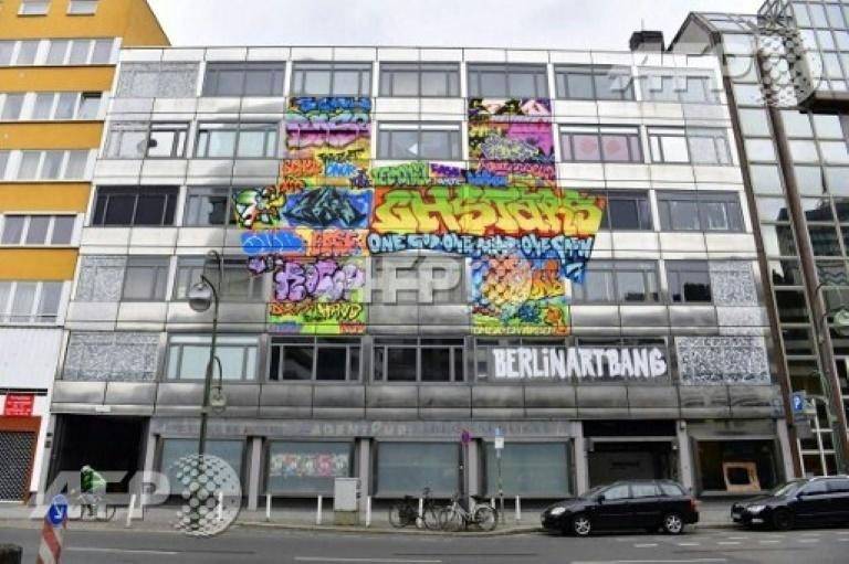 A condemned bank building in Berlin is the unlikely -- and temporary -- stage for artworks by 165 street artists, but only until the bulldozers roll in