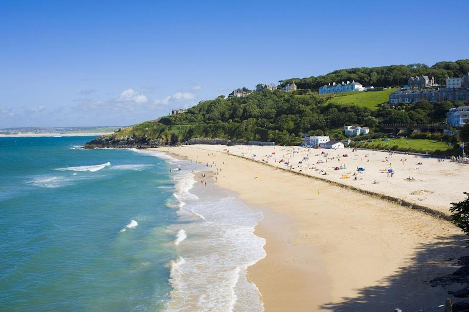 "<p>Framed by a glittering bay, Porthminster Beach has glorious views across to Godrevy Lighthouse, inspiration for Virginia Woolf's To the Lighthouse.</p><p><a class=""link rapid-noclick-resp"" href=""https://go.redirectingat.com?id=127X1599956&url=https%3A%2F%2Fwww.booking.com%2F&sref=https%3A%2F%2Fwww.cosmopolitan.com%2Fuk%2Fentertainment%2Ftravel%2Fg4958%2Fbest-beaches-in-uk%2F"" rel=""nofollow noopener"" target=""_blank"" data-ylk=""slk:FIND ACCOMMODATION"">FIND ACCOMMODATION </a><br></p>"
