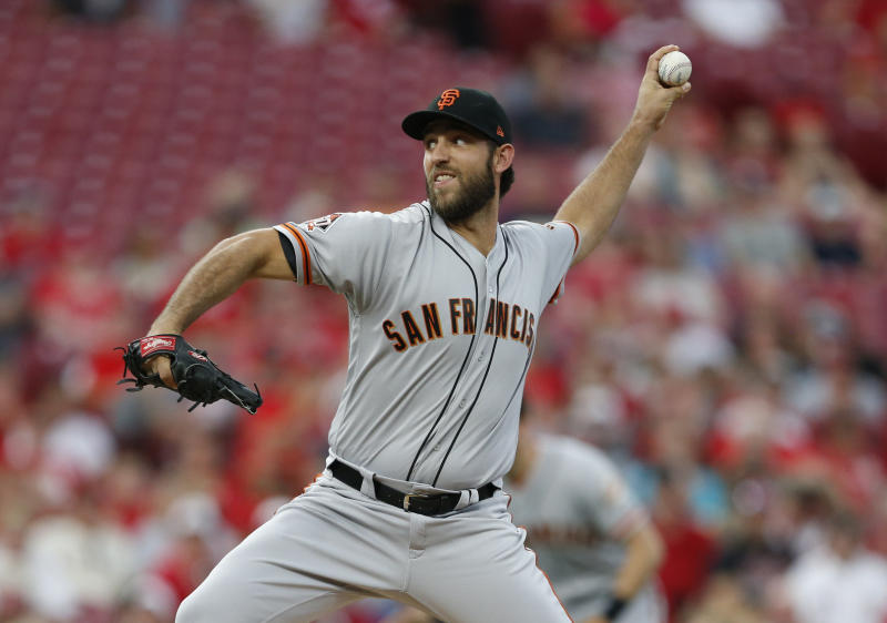 San Francisco Giants starting pitcher Madison Bumgarner throws against the Cincinnati Reds during the first inning of a baseball game Saturday, Aug. 18, 2018, in Cincinnati. (AP Photo/Gary Landers)