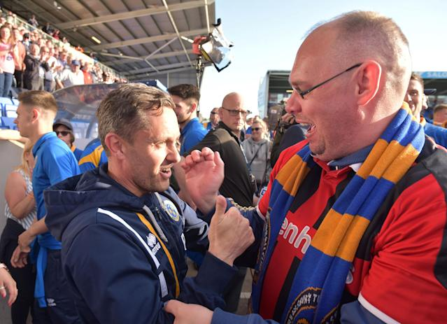 "Soccer Football - League One Play Off Semi Final Second Leg - Shrewsbury Town vs Charlton Athletic - Montgomery Waters Meadow, Shrewsbury, Britain - May 13, 2018 Shrewsbury Town manager Paul Hurst is hugged by a fan at full time Action Images/Paul Burrows EDITORIAL USE ONLY. No use with unauthorized audio, video, data, fixture lists, club/league logos or ""live"" services. Online in-match use limited to 75 images, no video emulation. No use in betting, games or single club/league/player publications. Please contact your account representative for further details."