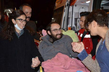 Semih Ozakca, a 28-year-old Turkish teacher who has been on hunger strike for months to protest about losing his job in the government's purge since a failed coup attempt last year and released from jail pending his trial on terrorism-related charges, is welcomed by his wife Esra Ozakca and friends as he arrives at his home in Ankara, Turkey, October 20, 2017. Picture taken October 20, 2017. Depo Photos via REUTERS
