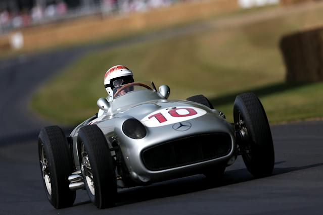 CHICHESTER, ENGLAND - JULY 14: Former F1 World Champion Sir Jackie Stewart drives the 1954 Mercedes W196 as he takes part in the Goodwood Festival of Speed on July 14, 2013 in Chichester, England. (Photo by Andrew Hone/Getty Images)