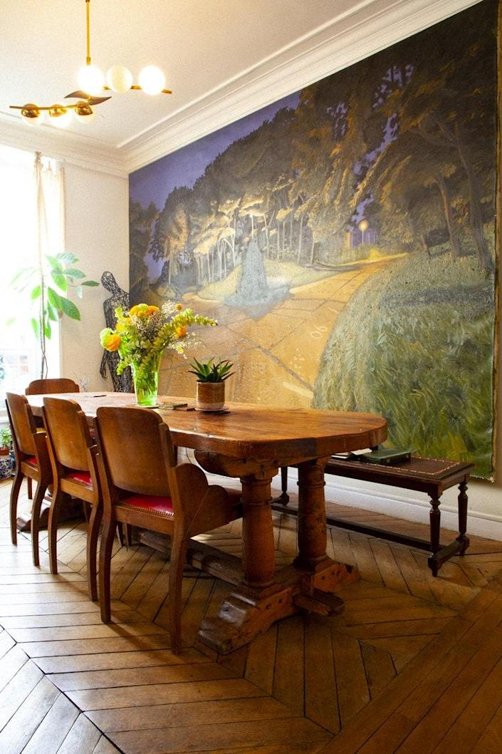 The massive painting in the dining room is by a favorite artist of Frédérique's, Joël Degbo.