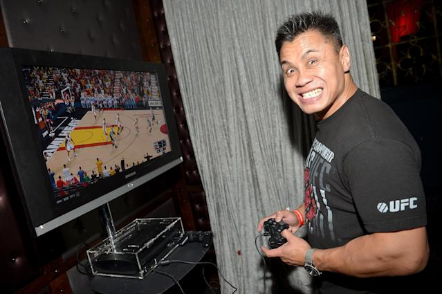 WEST HOLLYWOOD, CA - SEPTEMBER 24: MMA fighter Cung Le attends the NBA 2K14 premiere party at Greystone Manor on September 24, 2013 in West Hollywood, California. (Photo by Charley Gallay/Getty Images for 2K)