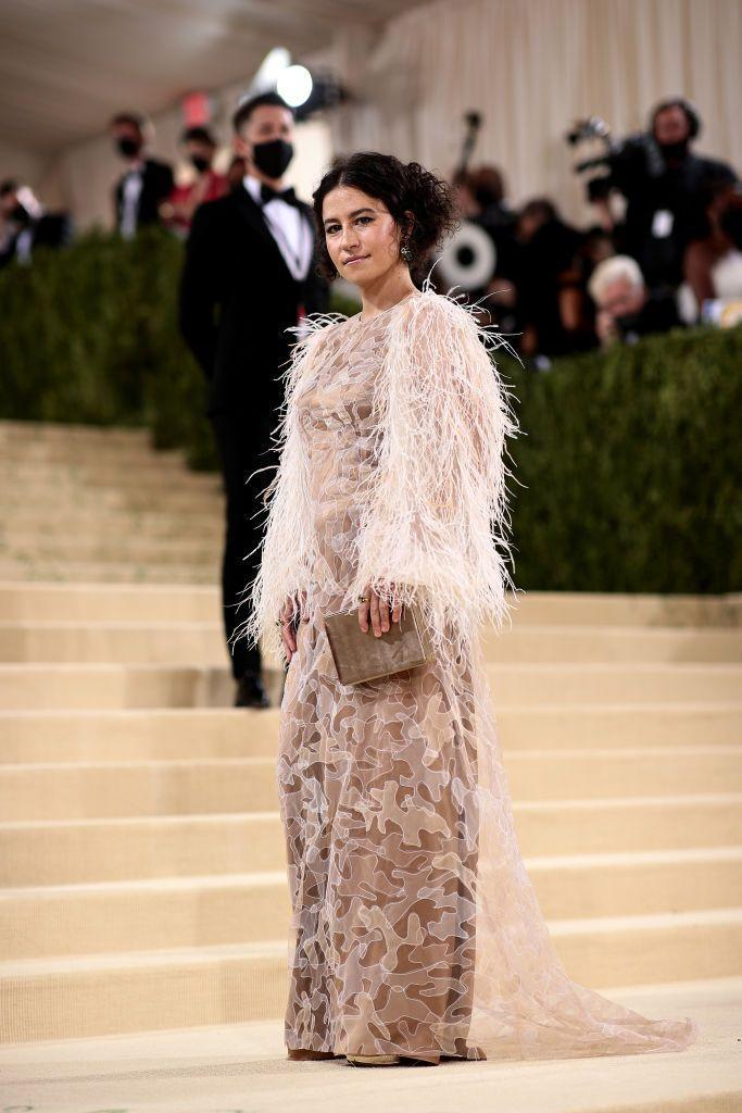<p>Actor Glazer wore a nude gown with feather sleeves by Aliétte.</p>