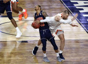 Samir Doughty #10 of the Auburn Tigers battles for the ball with Jack Salt #33 of the Virginia Cavaliers in the first half during the 2019 NCAA Final Four semifinal at U.S. Bank Stadium on April 6, 2019 in Minneapolis, Minnesota. (Photo by Hannah Foslien/Getty Images)