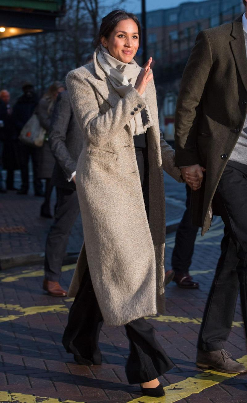 Meghan showed she's no fashion snob, stepping out in outfit that mixed high street with designer. Photo: Getty