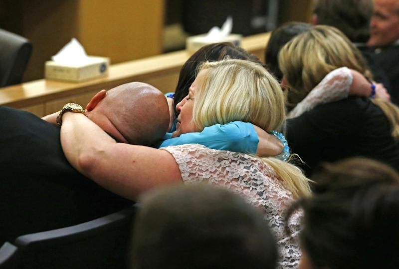 Family and friends of Travis Alexander react after Jodi Arias was found of guilty of first-degree murder in the gruesome killing of Alexander, her one-time boyfriend, in their suburban Phoenix home, Wednesday, May 8, 2013, in Phoenix. (AP Photo/The Arizona Republic, Rob Schumacher, Pool)