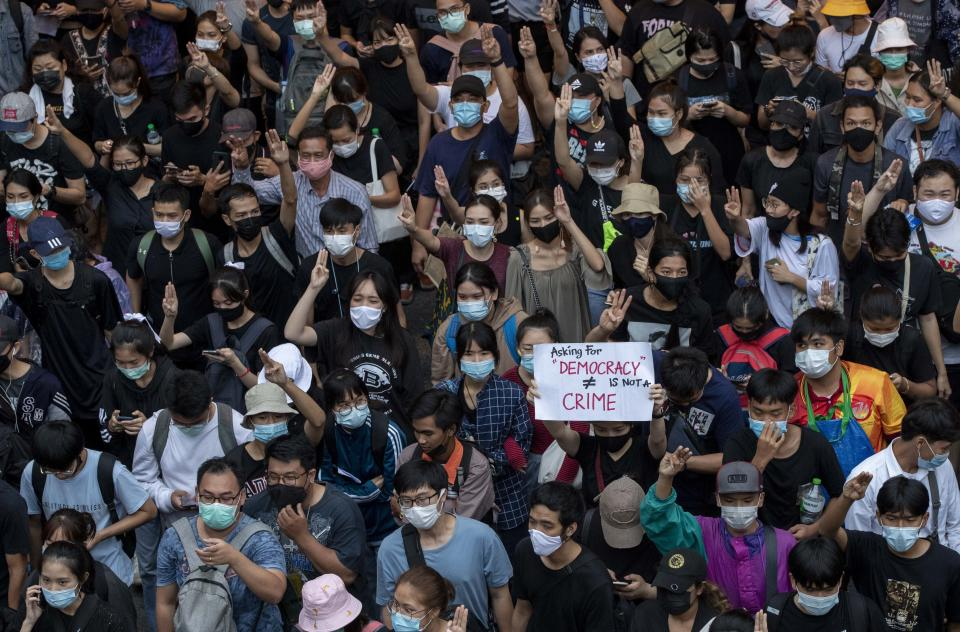 Pro-democracy protesters march during a protest in Udom Suk, suburbs of Bangkok, Thailand, Saturday, Oct. 17, 2020. The authorities in Bangkok shut down mass transit systems and set up roadblocks Saturday as Thailand's capital faced a fourth straight day of determined anti-government protests. (AP Photo/Gemunu Amarasinghe)