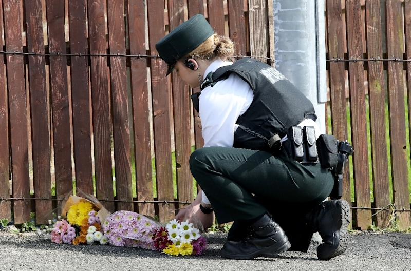 Wellwishers brought flowers to the spot where the journalist was shot dead in Derry/Londonderry (AFP Photo/Paul Faith)