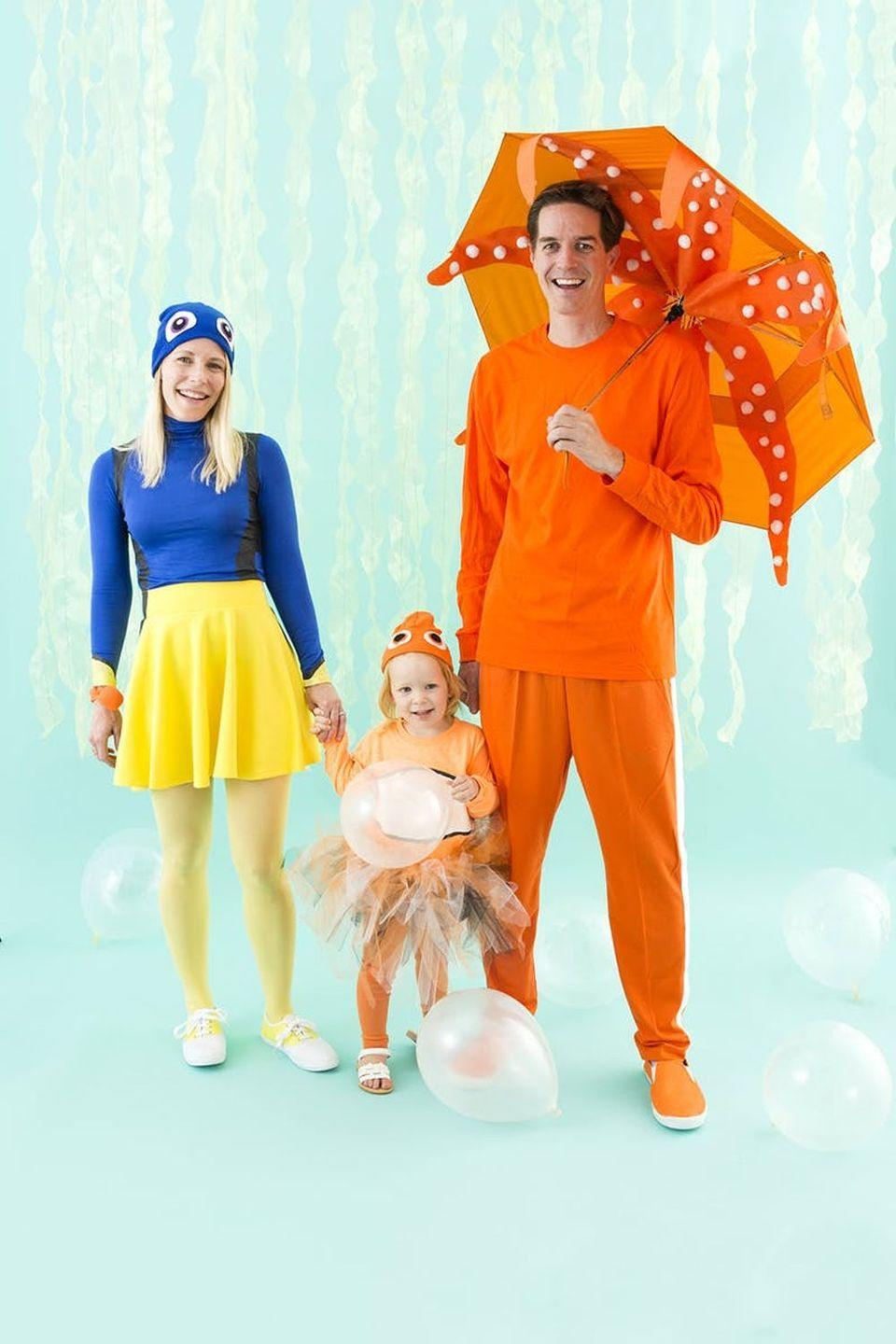 """<p>You know the characters—why not <em>be </em>the characters? This <em>Finding Dory</em> costume is simply delightful.</p><p><strong>Get the tutorial at <a href=""""https://www.brit.co/finding-dory-family-costume/"""" rel=""""nofollow noopener"""" target=""""_blank"""" data-ylk=""""slk:Brit + Co."""" class=""""link rapid-noclick-resp"""">Brit + Co.</a></strong></p><p><a class=""""link rapid-noclick-resp"""" href=""""https://www.amazon.com/Lewis-N-Clark-Lightweight-Automatically/dp/B00GFU6DEQ?tag=syn-yahoo-20&ascsubtag=%5Bartid%7C10050.g.29074815%5Bsrc%7Cyahoo-us"""" rel=""""nofollow noopener"""" target=""""_blank"""" data-ylk=""""slk:SHOP ORANGE UMBRELLAS"""">SHOP ORANGE UMBRELLAS</a></p>"""