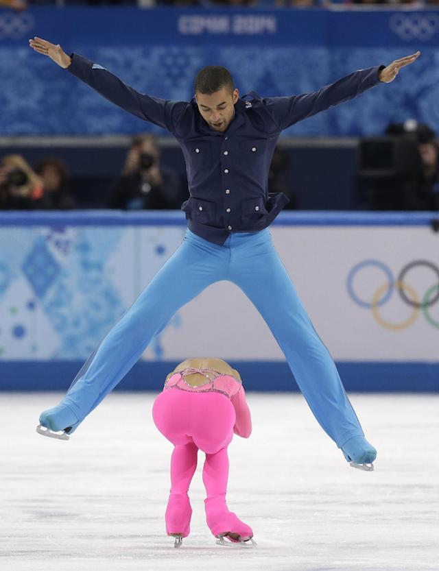 Aliona Savchenko and Robin Szolkowy of Germany compete in the pairs short program figure skating competition at the Iceberg Skating Palace during the 2014 Winter Olympics, Tuesday, Feb. 11, 2014, in Sochi, Russia. (AP Photo/Darron Cummings)