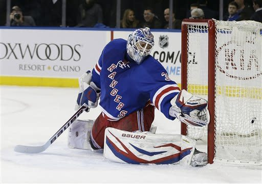 New York Rangers goalie Henrik Lundqvist (30) reaches for a puck shot by Carolina Hurricanes' Eric Staal for a goal during the first period of an NHL hockey game, Monday, March 18, 2013, in New York. (AP Photo/Frank Franklin II)