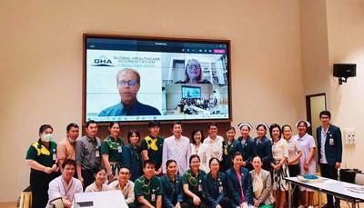 Ratchaphruek Hospital's CEO, Dr. Teerawat Srinakarin, along with staff and GHA's CEO, Ms. Karen Timmons and Bill Cook, Director of Business Development, as the latter announce their certification remotely.