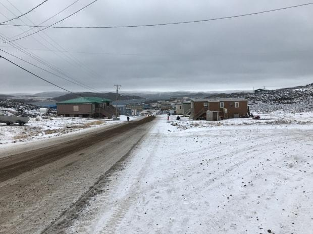 Two new cases of COVID-19 were reported in Kinngait, Nunavut on Thursday. There's also 10 new cases in Iqaluit and one reported recovery. (Sara Frizzell/CBC - image credit)