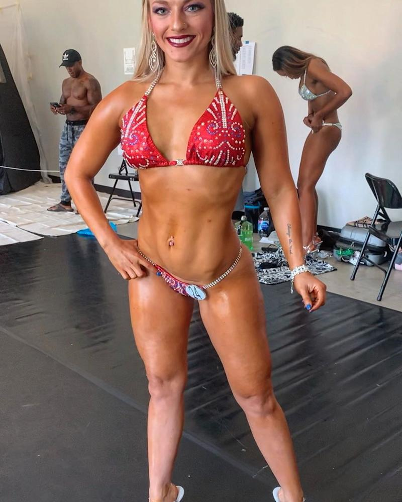 Mackenzie McKee poses in a bikini at a fitness competition