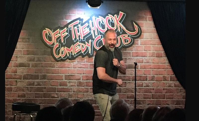 Ahmed Ahmed onstage at Off the Hook Comedy in Naples, Fla. (Photo: Off the Hook Comedy via Twitter)