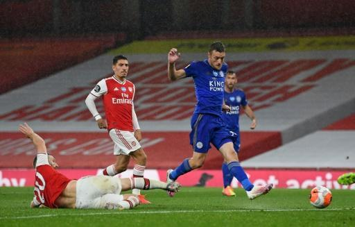 Fox in the box: Jamie Vardy (centre)salvaged a point for Leicester at Arsenal