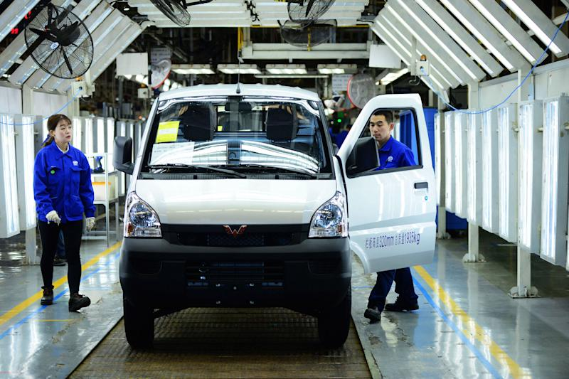 Workers inspect the finished vehicles in an SGMW subsidiary factory in Qingdao in east China's Shandong province Monday, April 29, 2019. SGMW is a joint venture between three automakers - SAIC Motor Corporation, Liuzhou Wuling Motors, and GM China. (Photo credit should read YU FANGPING / Barcroft Media via Getty Images)